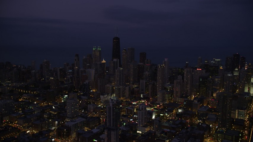 5K stock footage aerial video of Downtown Chicago cityscape at nighttime, Illinois Aerial Stock Footage | AX0003_137