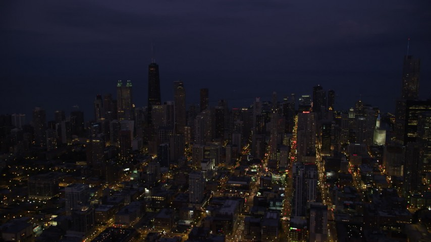 Downtown Chicago skyscrapers and high-rises at night, Illinois Aerial Stock Footage | AX0003_138