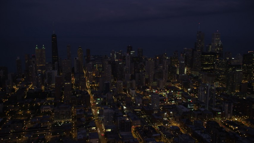 Passing by Downtown Chicago cityscape at night, Illinois Aerial Stock Footage | AX0003_139
