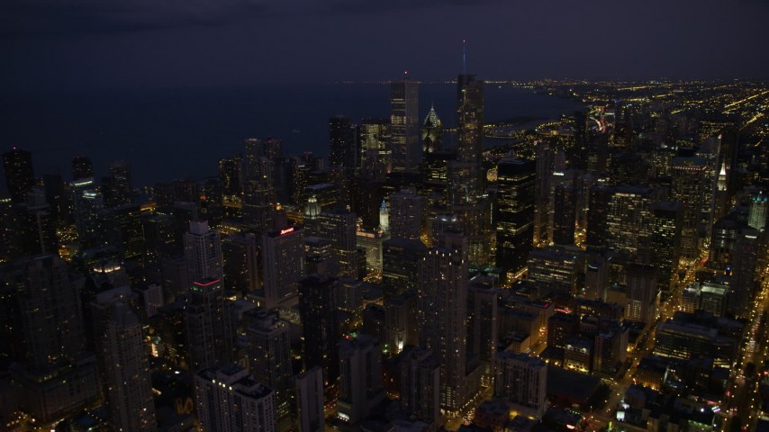 Flying over Downtown Chicago at night, Illinois Aerial Stock Footage AX0003_142