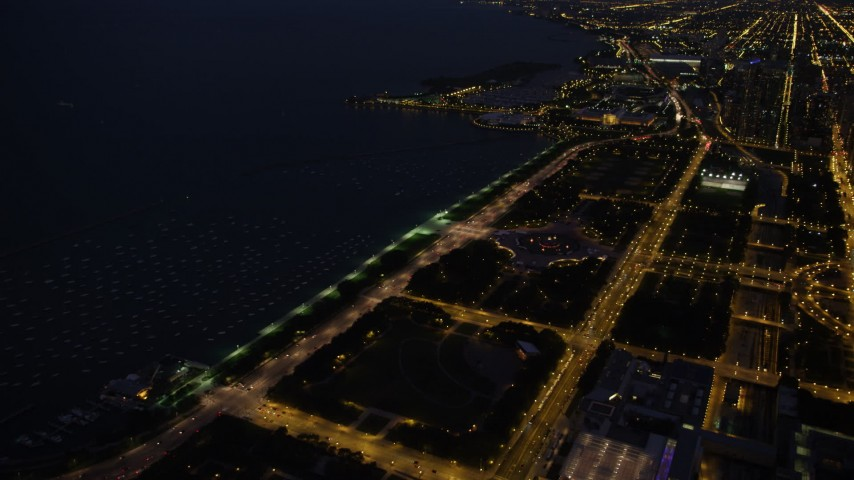 Approaching Buckingham Fountain in Grant Park, Downtown Chicago, Illinois, night Aerial Stock Footage | AX0003_146