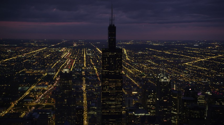 5K stock footage aerial video of orbiting Willis Tower on a cloudy night, Downtown Chicago, Illinois Aerial Stock Footage | AX0003_147