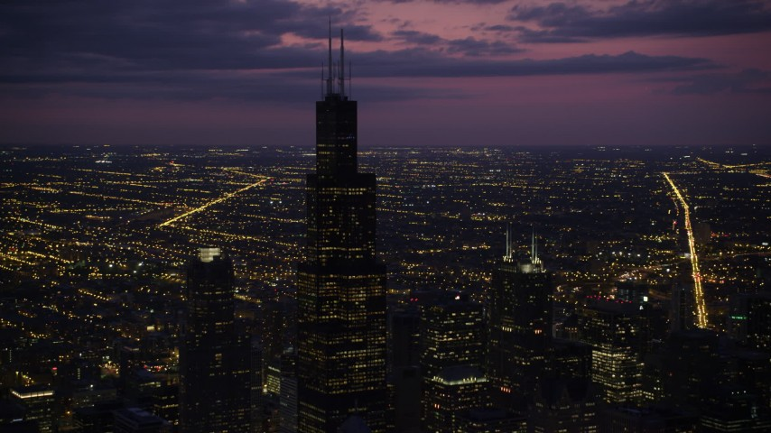 5K stock footage aerial video of an orbit of Willis Tower, on a cloudy day at night, Downtown Chicago, Illinois Aerial Stock Footage | AX0003_148