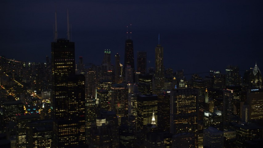 5K stock footage aerial video approach Downtown Chicago skyscrapers and Willis Tower at night, Illinois Aerial Stock Footage | AX0003_153