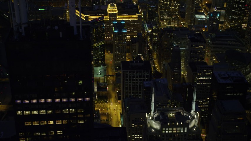5K stock footage aerial video of flying by Willis Tower at night and tilt to N Franklin Street, Downtown Chicago, Illinois Aerial Stock Footage | AX0003_155