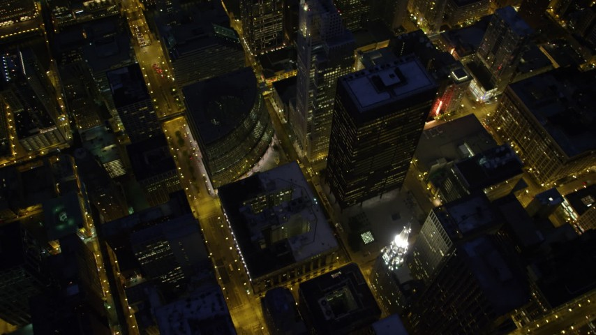 5K stock footage aerial video of tilt from city streets revealing Chicago River and skyscrapers, at night, Downtown Chicago, Illinois Aerial Stock Footage | AX0003_156