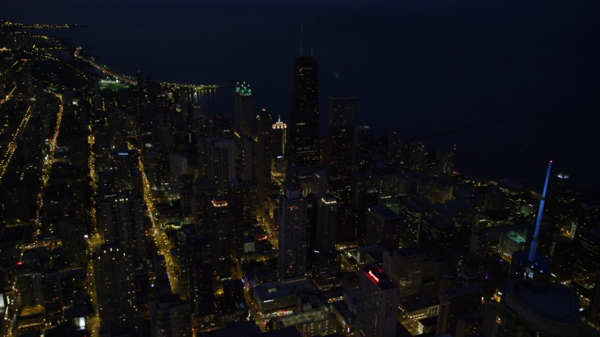 Flying over Downtown Chicago toward John Hancock Center, at night, Illinois Aerial Stock Footage | AX0003_157