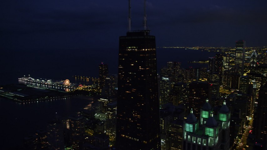 5K stock footage aerial video orbit John Hancock Center, reveal Navy Pier, Downtown Chicago, Illinois, night Aerial Stock Footage | AX0003_158