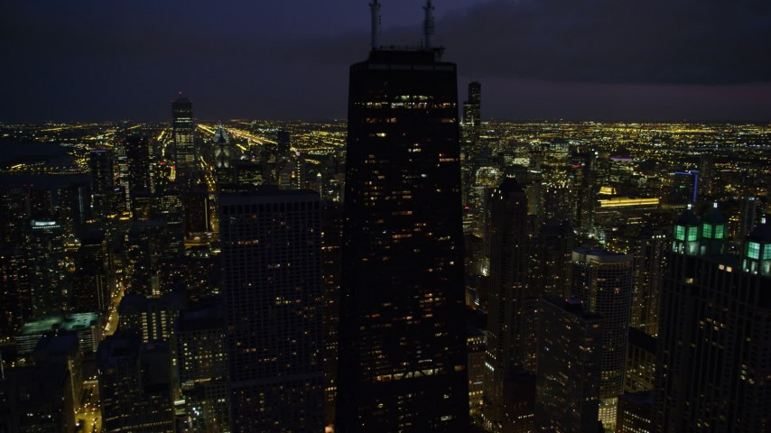 Orbiting John Hancock Center and Downtown Chicago skyscrapers, at night, Illinois Aerial Stock Footage | AX0003_159