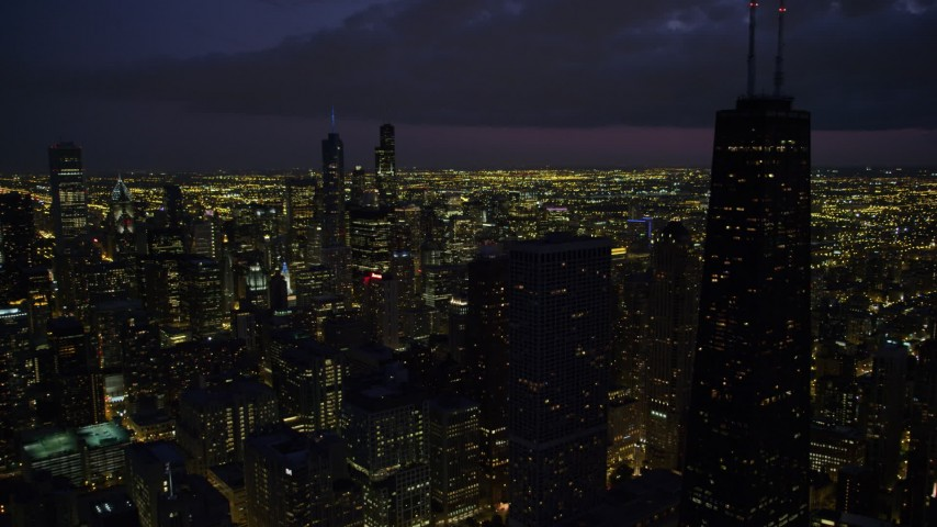 5K stock footage aerial video of Downtown Chicago cityscape and John Hancock Center, at night with clouds, Illinois Aerial Stock Footage | AX0003_160