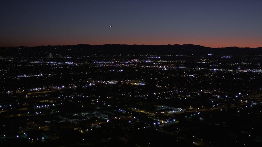 5K stock footage aerial video of flying over Van Nuys suburban neighborhoods at night, California Aerial Stock Footage   AX0004_003