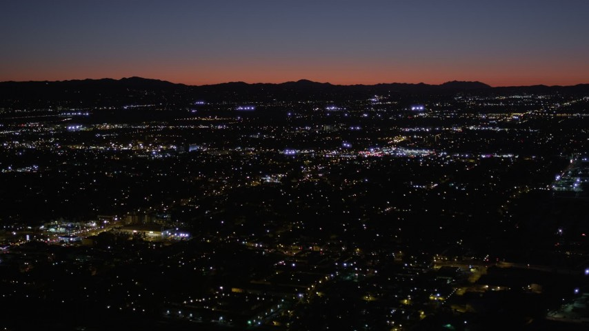 5K stock footage aerial video of Van Nuys suburban neighborhoods at night, California Aerial Stock Footage   AX0004_004