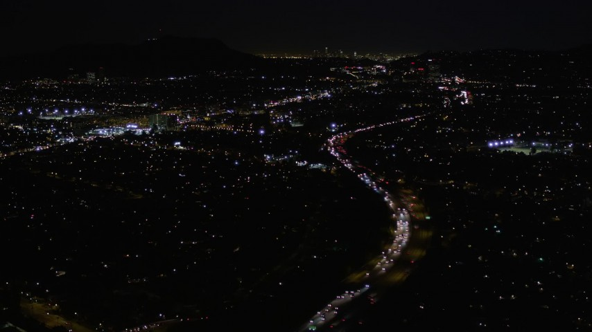 Fly Over Interstate 170 at Night through Universal City, California Aerial Stock Footage | AX0004_006