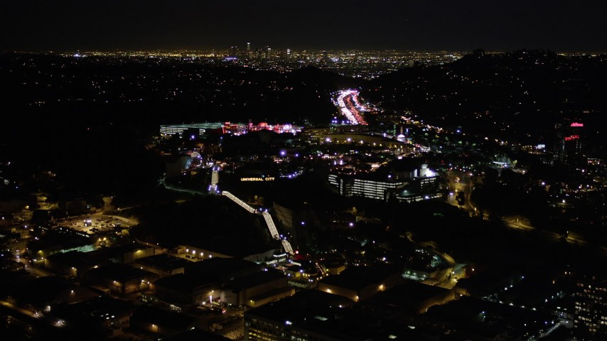 5K stock footage aerial video of approaching Universal Studios Hollywood at night, California Aerial Stock Footage | AX0004_007