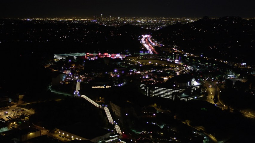 Flying Over Universal Studios Hollywood at Night Aerial Stock Footage | AX0004_008