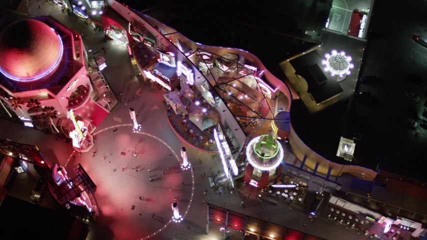 5K stock footage aerial video bird's eye view of Hard Rock Cafe and Universal City Walk at night, California Aerial Stock Footage | AX0004_009