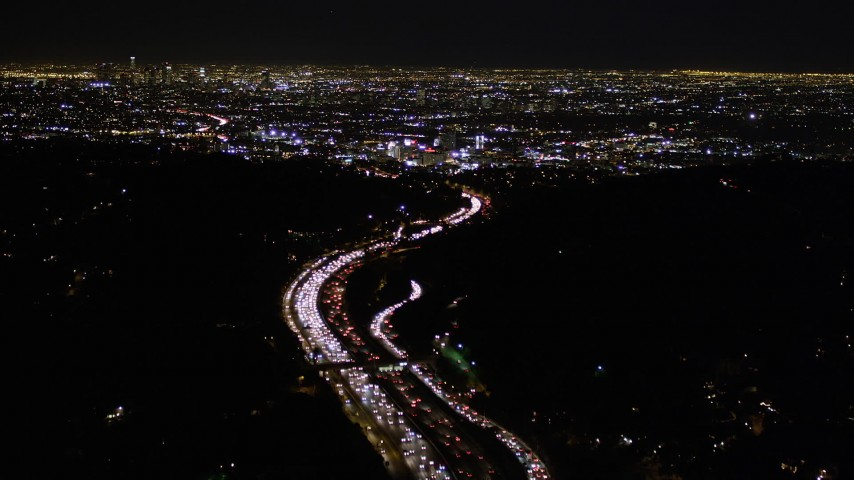 5K stock footage aerial video of following Highway 101 at night toward Hollywood, California Aerial Stock Footage | AX0004_010