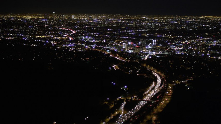 Fly Over Nighttime Traffic on Highway 101 to Hollywood Aerial Stock Footage | AX0004_011