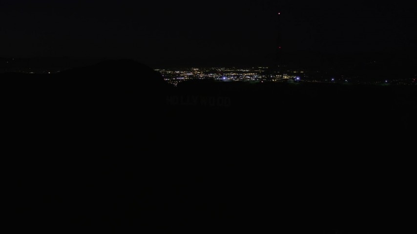 5K stock footage aerial video orbit radio tower atop the Hollywood Hills at night, California Aerial Stock Footage | AX0004_012E