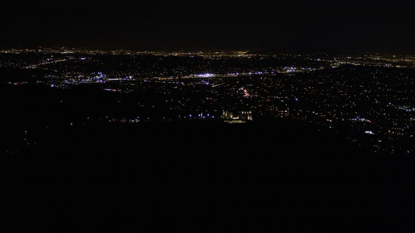 Approach Griffith Observatory at Nighttime in California Aerial Stock Footage | AX0004_014