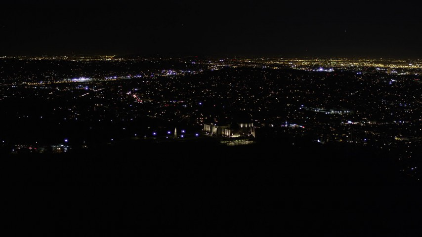 5K stock footage aerial video orbit Griffith Observatory at night, California Aerial Stock Footage | AX0004_015