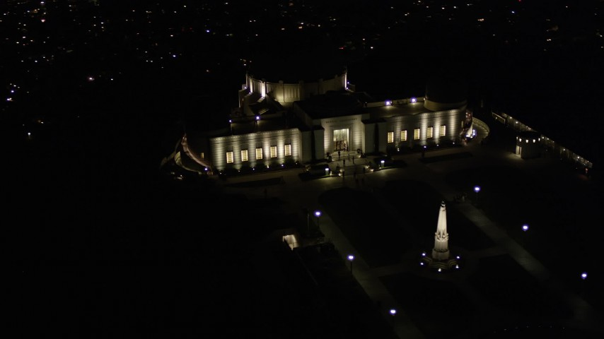 5K stock footage aerial video of orbiting east side of Griffith Observatory at night, California Aerial Stock Footage   AX0004_017