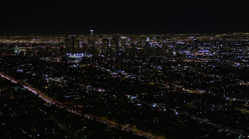 5K stock footage aerial video tilt and reveal Downtown Los Angeles skyscrapers at night, California Aerial Stock Footage   AX0004_018E
