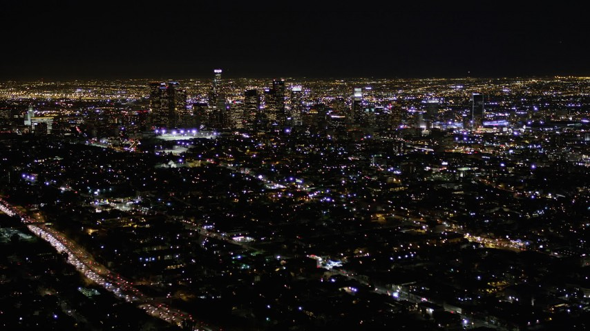 Approach Skyscrapers in Downtown Los Angeles at Night Aerial Stock Footage | AX0004_019
