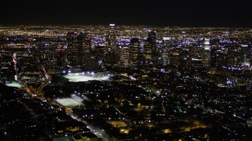 5K stock footage aerial video of flying toward Downtown Los Angeles at nighttime in California Aerial Stock Footage | AX0004_020