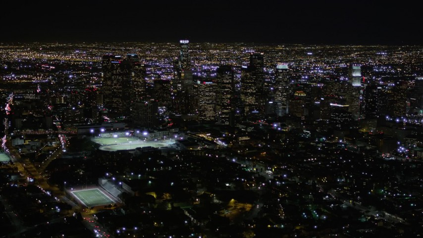 5K stock footage aerial video of flying toward Downtown Los Angeles at nighttime in California Aerial Stock Footage | AX0004_020E