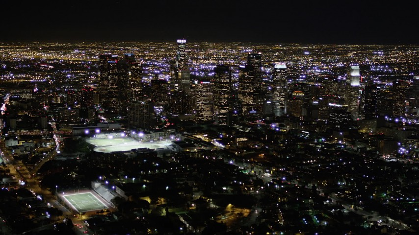 5K stock footage aerial video of approaching Downtown Los Angeles at night, California Aerial Stock Footage | AX0004_021