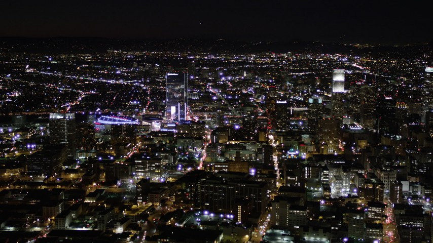 Orbit Skyscrapers near Staples Center at Night in Downtown Los Angeles Aerial Stock Footage | AX0004_025