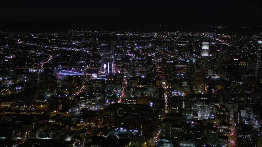 5K stock footage aerial video orbit skyscrapers near Staples Center at night in Downtown Los Angeles, California Aerial Stock Footage | AX0004_025E