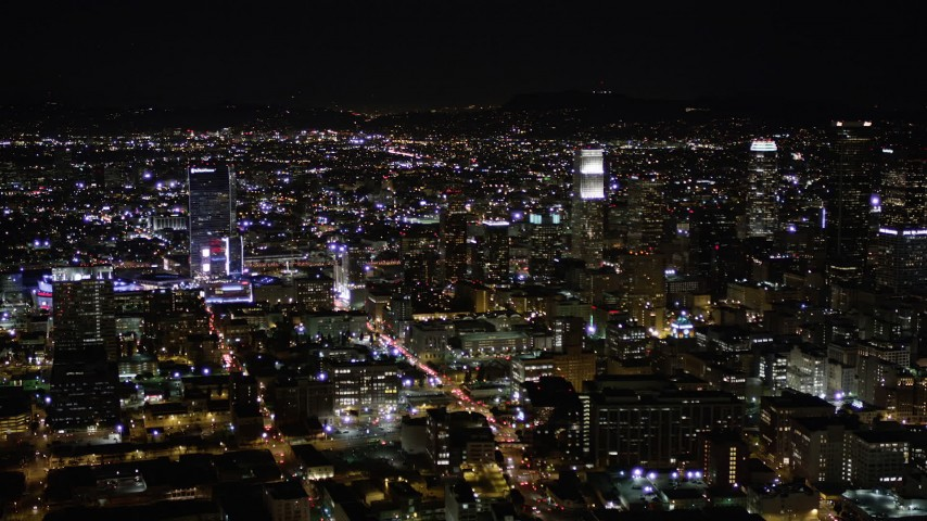 Orbit of Skyscrapers at Night in Downtown Los Angeles Aerial Stock Footage | AX0004_026