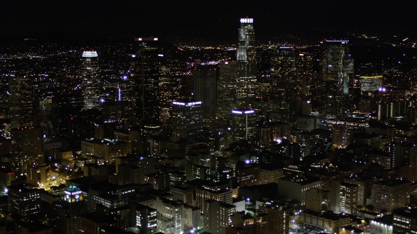 Tilt Up to Reveal Downtown Los Angeles Skyscrapers at Night Aerial Stock Footage | AX0004_027