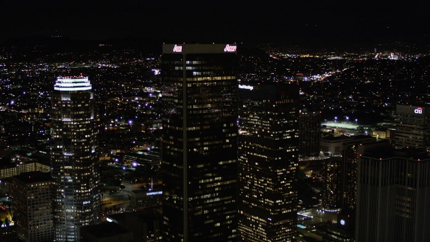 Approach Aon Center at Night in Downtown Los Angeles Aerial Stock Footage | AX0004_028
