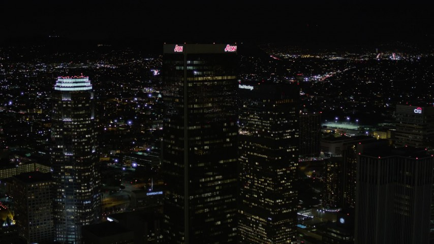 Approach and Fly Over Aon Center at Night in Downtown Los Angeles Aerial Stock Footage | AX0004_029