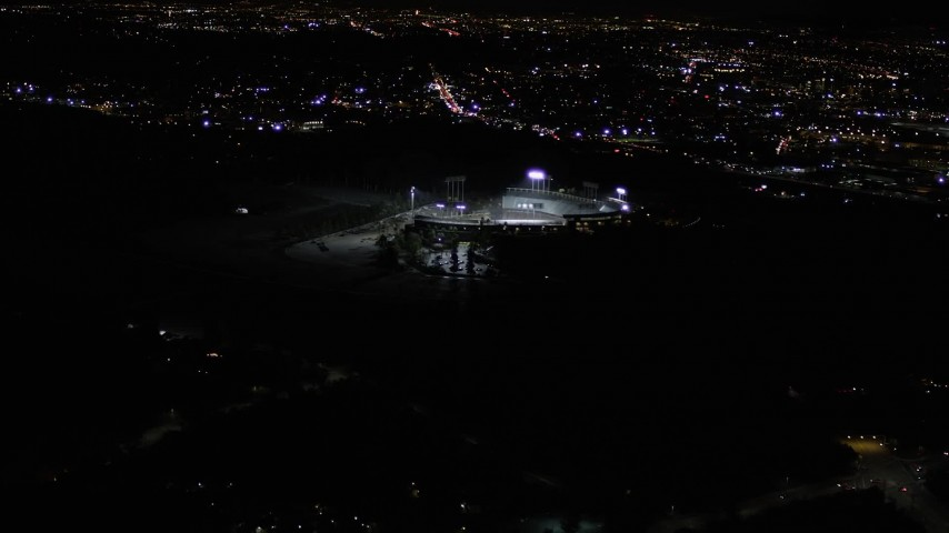 5K stock footage aerial video orbit Dodger Stadium at night in Los Angeles, California Aerial Stock Footage | AX0004_032
