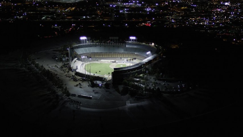 5K stock footage aerial video orbit Dodger Stadium with lights at night in Los Angeles, California Aerial Stock Footage | AX0004_033