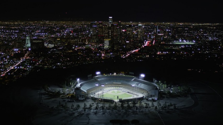 5K stock footage aerial video approach heavy traffic on Interstate 5, tilt to reveal stadium and downtown, Cypress Park, Los Angeles, California Aerial Stock Footage | AX0004_035E