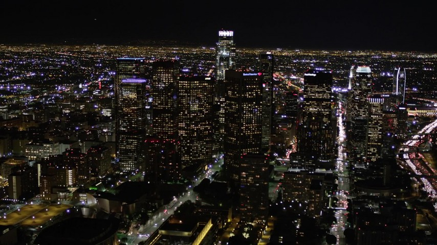 Approach Downtown Los Angeles Skyscrapers at Night Aerial Stock Footage | AX0004_039