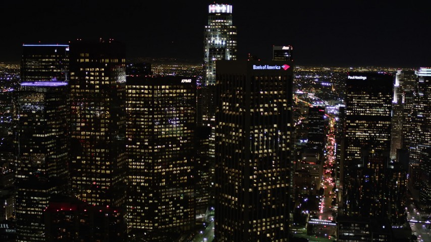 Approach Bank of America Center at Night in Downtown Los Angeles Aerial Stock Footage | AX0004_040
