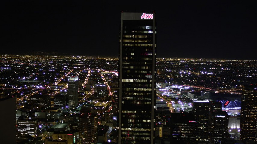 Fly Over KPMG and Approach Aon Center at Night in Downtown Los Angeles Aerial Stock Footage | AX0004_041