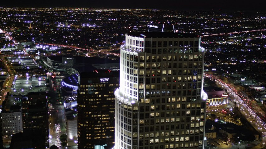 5K stock footage aerial video flyby Aon Center and 777 Tower to reveal Staples Center at night in Downtown Los Angeles, California Aerial Stock Footage | AX0004_042