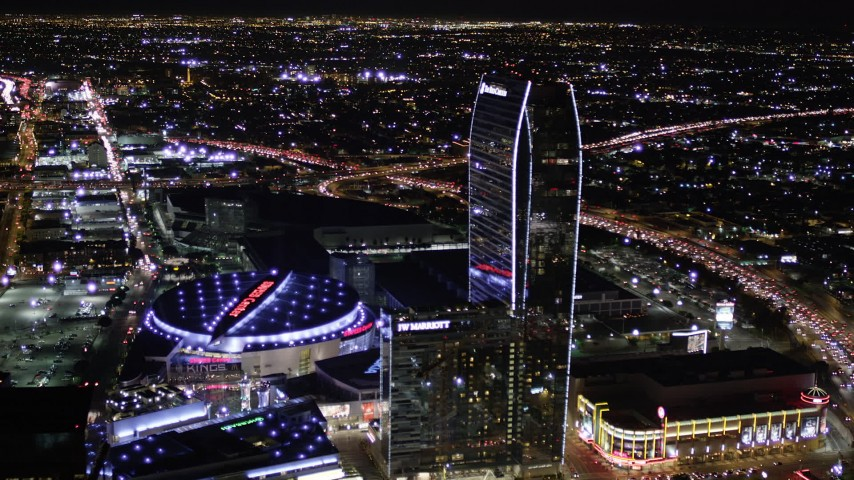 Orbit Staples Center and The Ritz-Carlton at Night in Downtown Los Angeles Aerial Stock Footage | AX0004_043