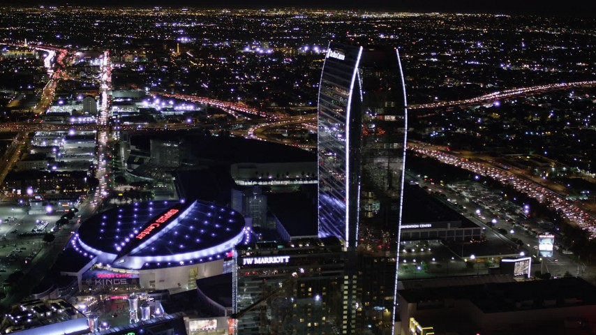 5K stock footage aerial video orbit Staples Center and The Ritz-Carlton at night in Downtown Los Angeles, California Aerial Stock Footage | AX0004_043