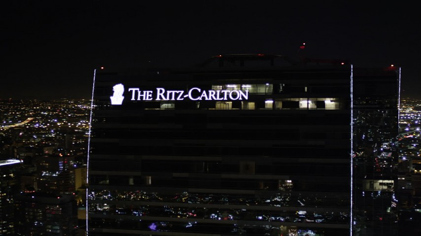 Orbit Ritz-Carlton Hotel at Night in Downtown Los Angeles Aerial Stock Footage | AX0004_044