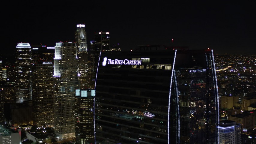 Ritz-Carlton Hotel and Downtown Los Angeles Skyscrapers at Night Aerial Stock Footage | AX0004_045