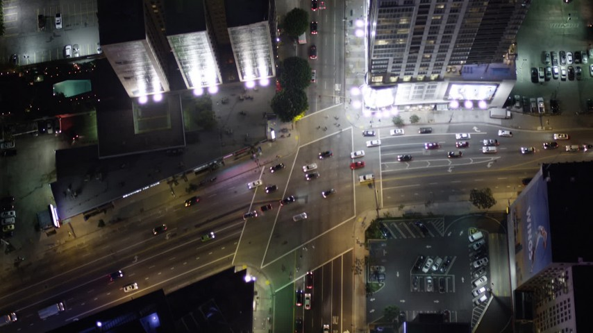 Bird's Eye View of South Figueroa Street at Night in Downtown Los Angeles Aerial Stock Footage | AX0004_046