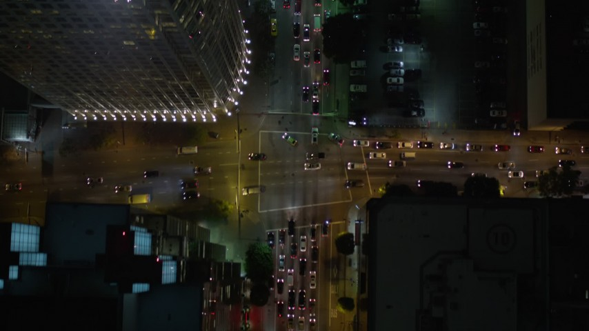 5K stock footage aerial video bird's eye view of South Figueroa Street at night in Downtown Los Angeles, California Aerial Stock Footage | AX0004_046E